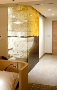 "Features: Partition walls of 1/2"" low-iron, imaged glass encapsulate the bathrooms and add a unique visual and architectural design element to every room."
